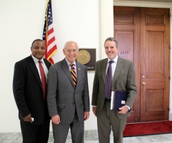 Photo of Arley Johnson, Bob Scott, and Representative Tonko pose outside of the briefing room